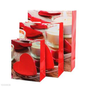 Small size red paper bag with heart pattern and soft handle