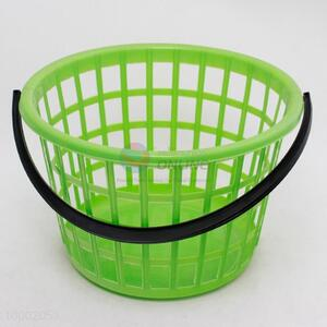 Plastic laundry basket with a handle