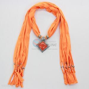 Fashionable orange scarves with jewelry