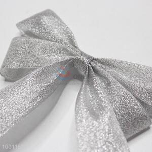 Delicate silver metallic bowknot