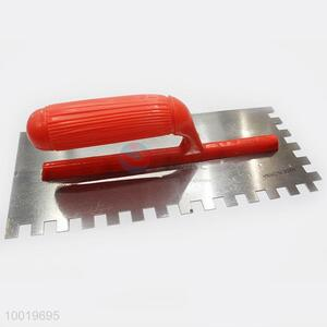 Notched iron trowel with red plastic handle 28*12cm