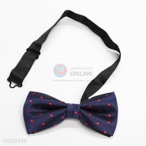 Dark blue with red dot bow tie