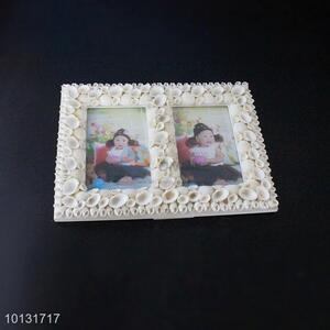 White <em>photo</em> frames with shell